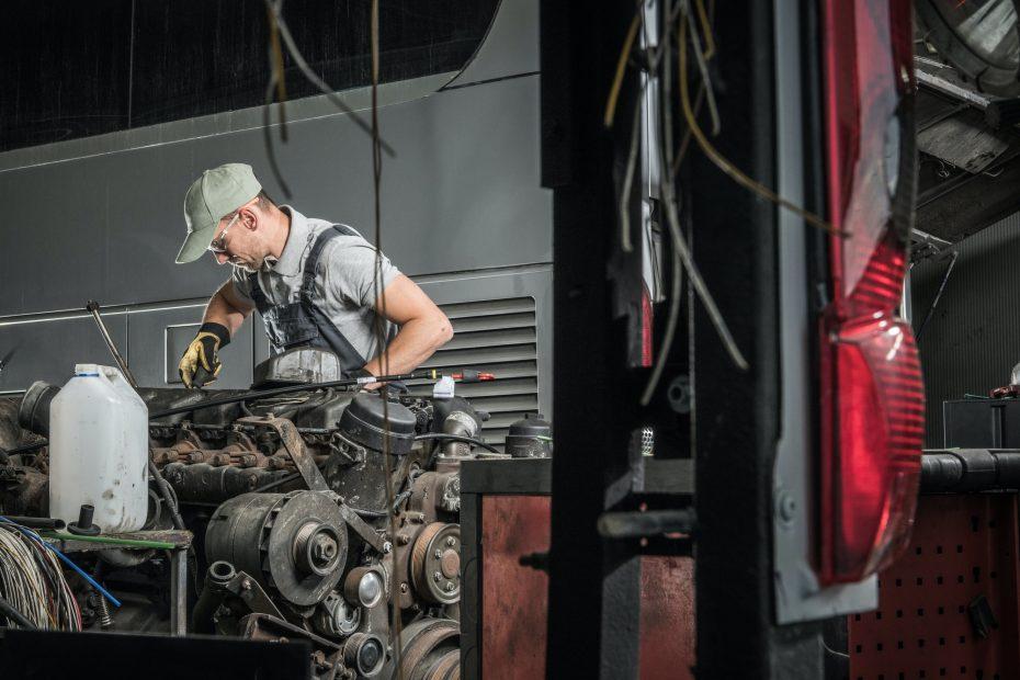 Automotive Technician Restoring Old Diesel Engine